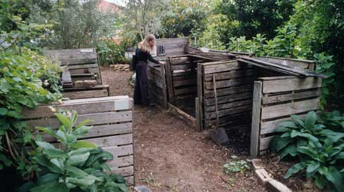 The contents of open compost bays are best turned from bay to bay each week for a hot, rapid compost.