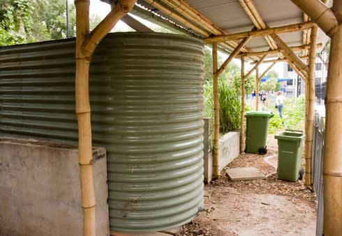 On oblong-shaped rainwater storage tank collects water falling on the shelter roof at Woolloomooloo Community Garden, Sydney.